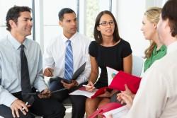 Businesspeople Having Informal Office Meeting